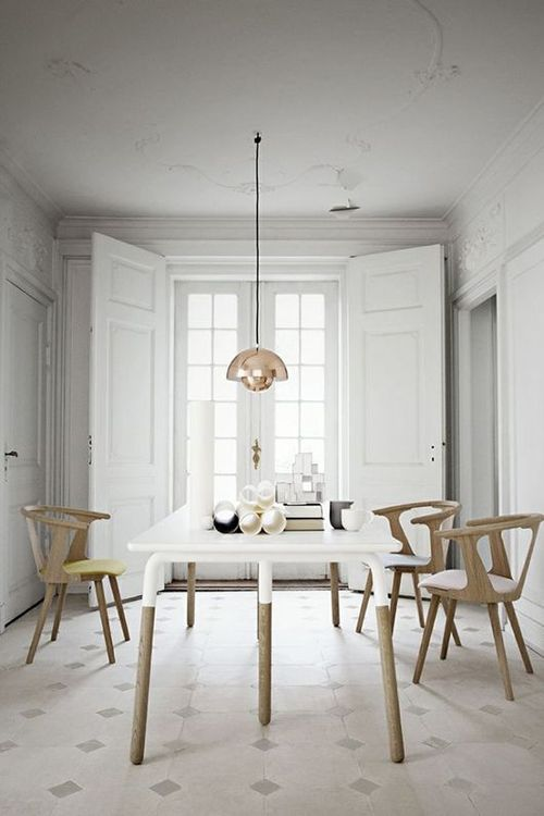 Organic Modern Dining Room with Wooden Dining Chairs and Brass Hanging Light.