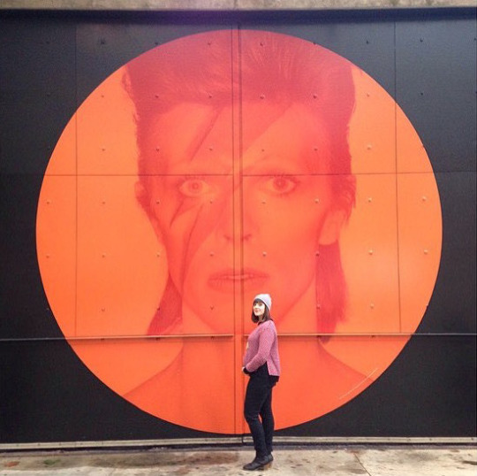 Jaime Rovenstine in front of a Bowie mural