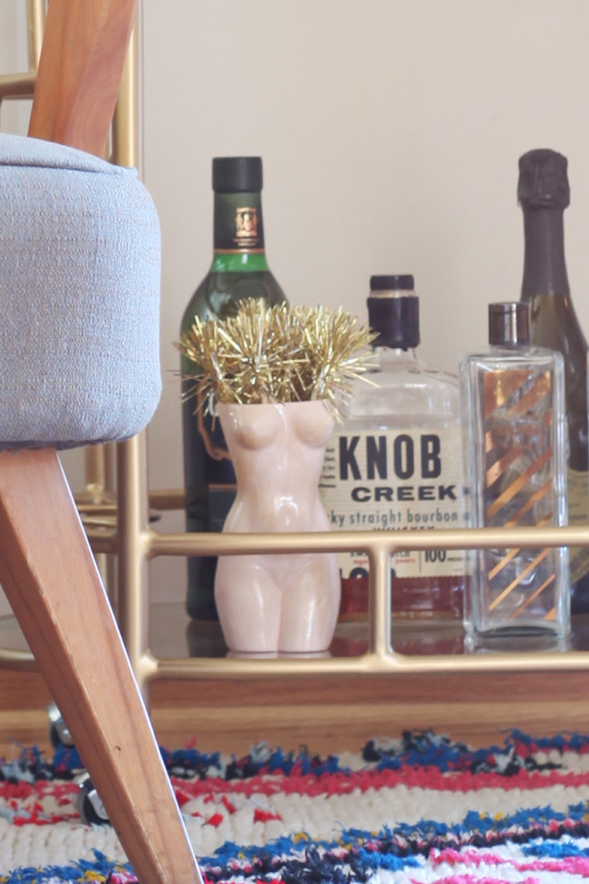 Modern Gold Bar Cart with Naked Female Vase on Chairish.