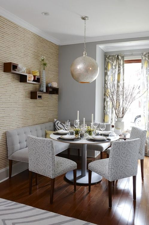 Contemporary Modern Dining Table with Grey Pattern Dining Chairs and Circular Hanging Lantern.