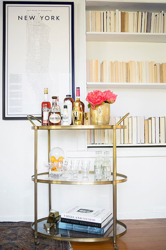 A brass bar cart with peonies