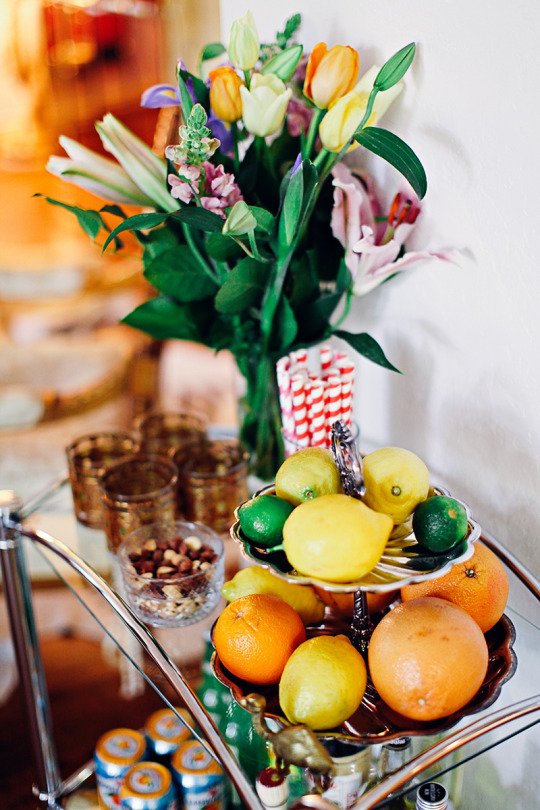 A close up of a bar cart with bright colored fruit