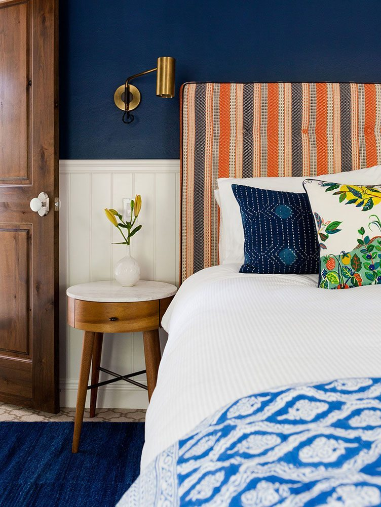 Boho Modern Bedroom With Colorful Striped Headboard and Colorful Decorative Pillows