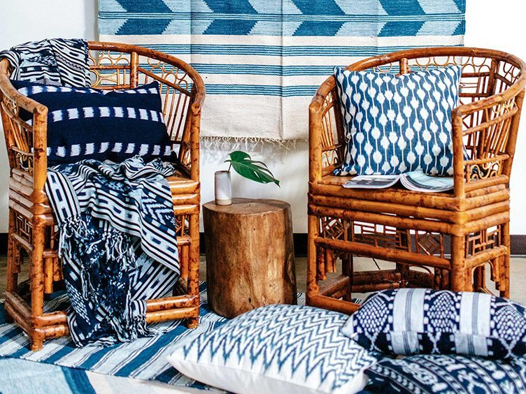 Boho Modern Style Set of Rattan Chairs With Blue and White Blankets and Pillows