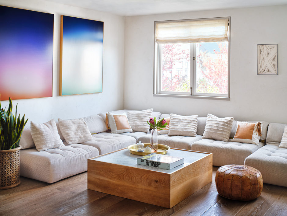 White Mah Jong Style Sofa in Cream Tufted Linen with Gradient Abstract Art Hung Above