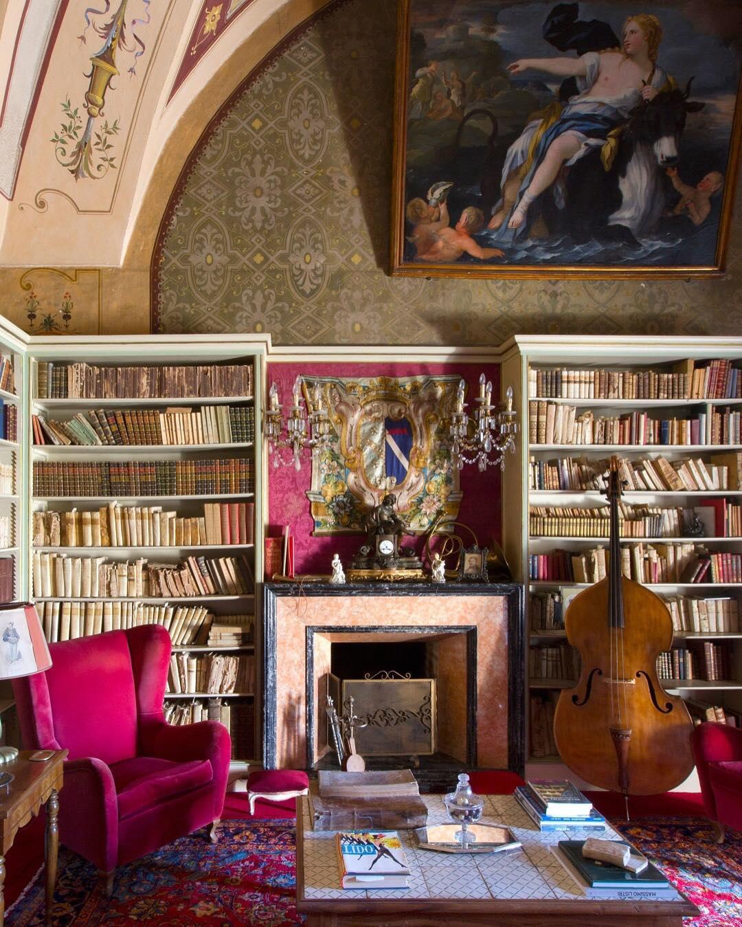 oberto gili home library bookshelves pink velvet reading chair bass fireplace renaissance art