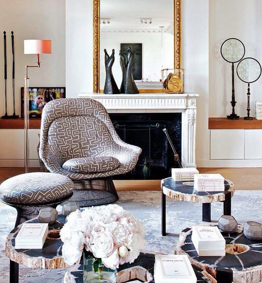 nuevo estilo living room reading chair club lounge ottoman books flowers fireplace