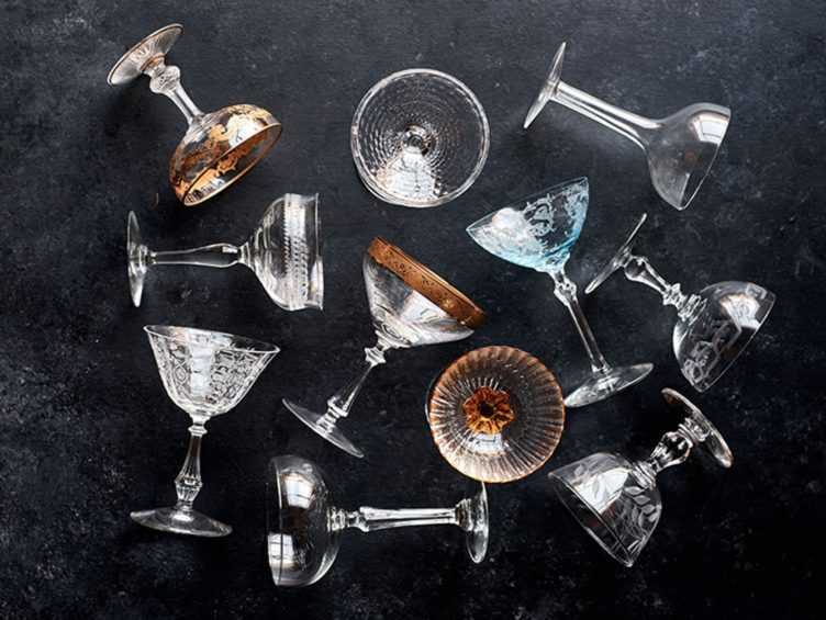 Vintage cocktail glasses with gold details.