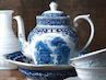 blue and white delft teapot with basin and white ceramic wares