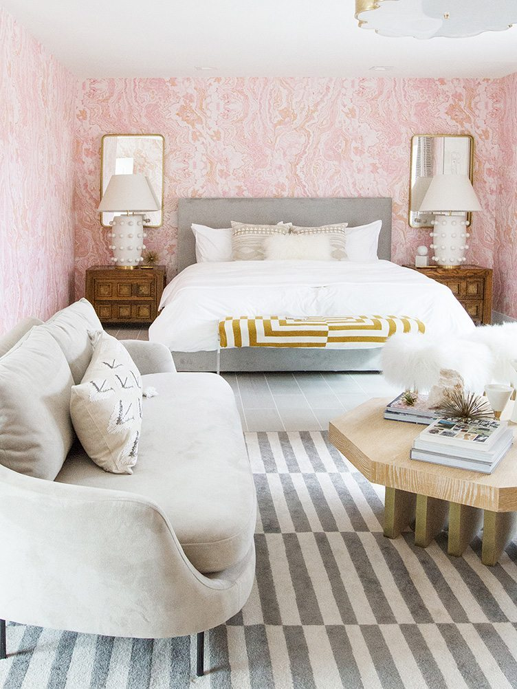 Sarah Sherman Samuel - Contemporary white bed, grey sofa, wood coffee table in pink bedroom