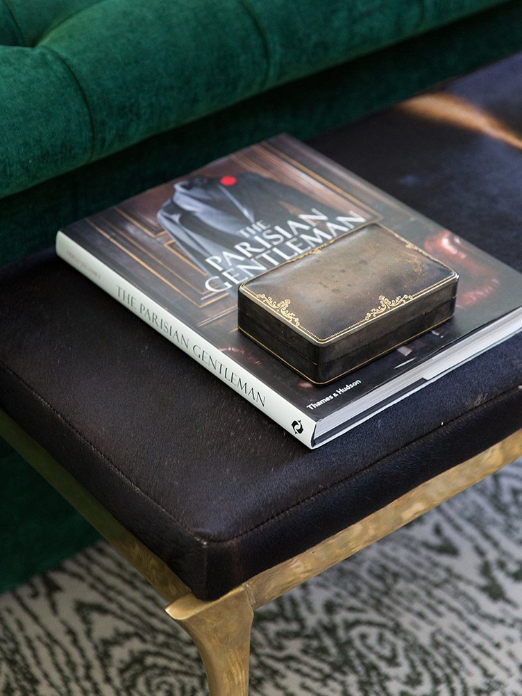 Leather bench a-topped by books