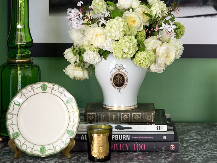 Assorted green decor, flowers, and books
