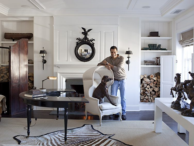 Darryl Carter with dog friend in living room