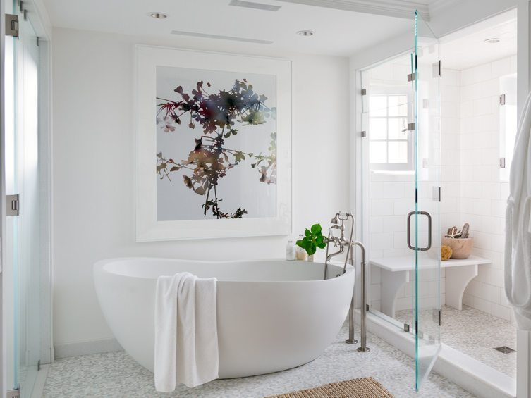 Contemporary master bath with clean colors and large wall art
