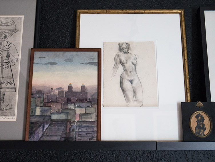 Sketch of Nude Women Next to Water Color Painting of City Scape.