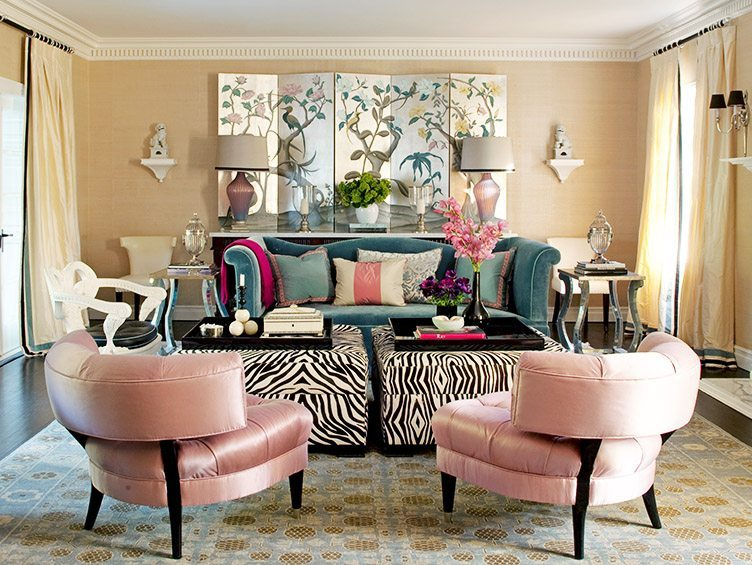 Pink slipper chairs in glamorous living room with zebra print coffee tables and asian panelling on the walls.
