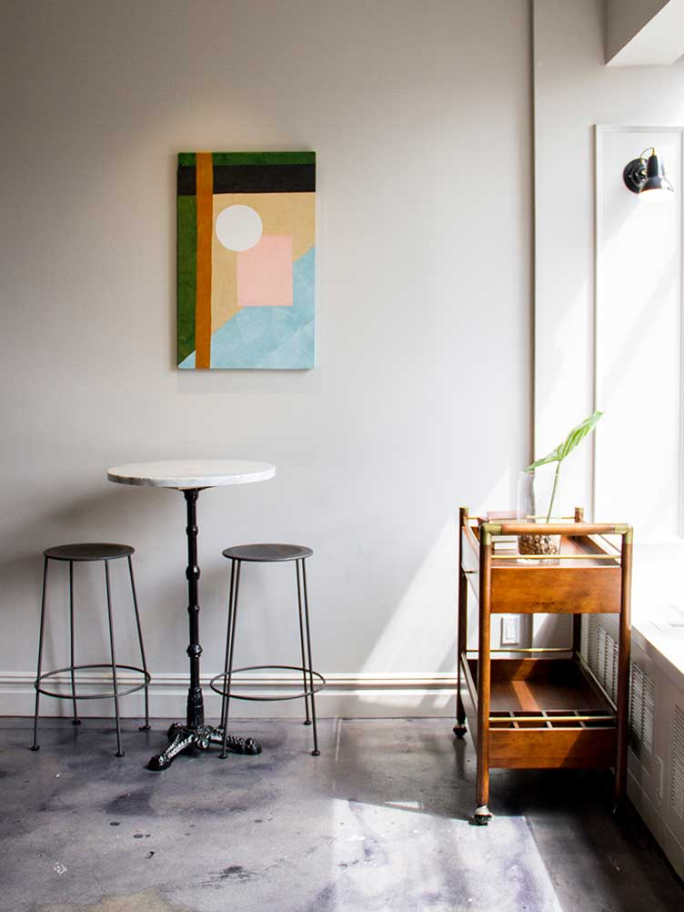 Restaurant Interior with Abstract Geometric Painting and Minimalist Metal Bar Stools