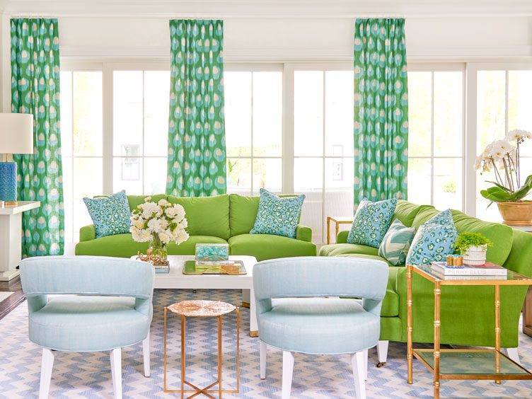 Colorful Living Room With Lime Green Couches and Blue and Green Decorative Pillows.