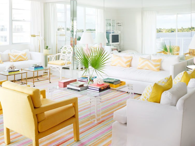 Colorful Living Room with Yellow Decorative Pillows and ArmChair on Striped Rug.