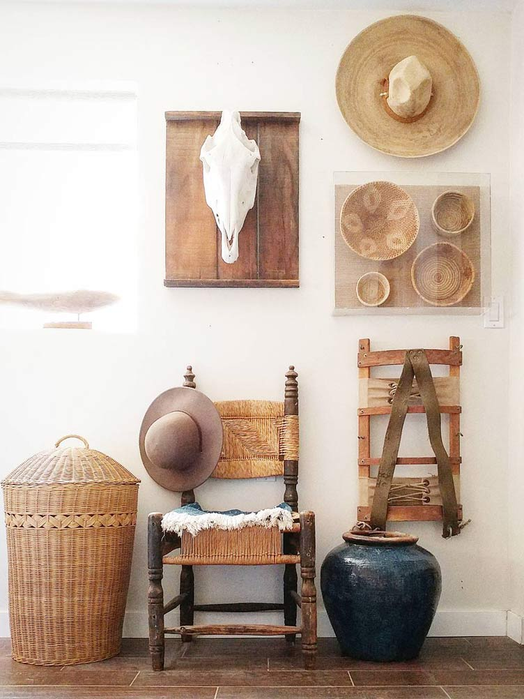 Mexican chair mounted on Wall with Cow Skull, Hats, Framed Basketry, a Hamper