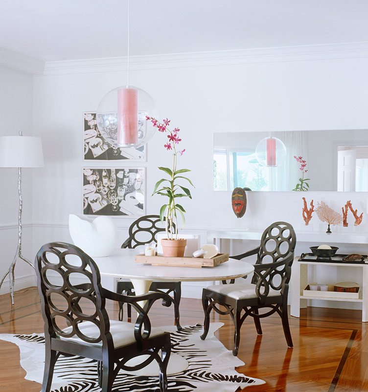 Eclectic Dining Room With Large Glass Hanging Lamp and Black and White Color Scheme.