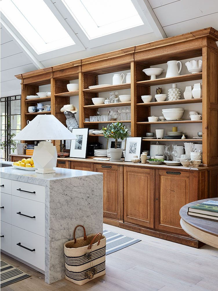 Rustic Kitchen With Wooden Armoire and White Ceramic Bowls and Vases.