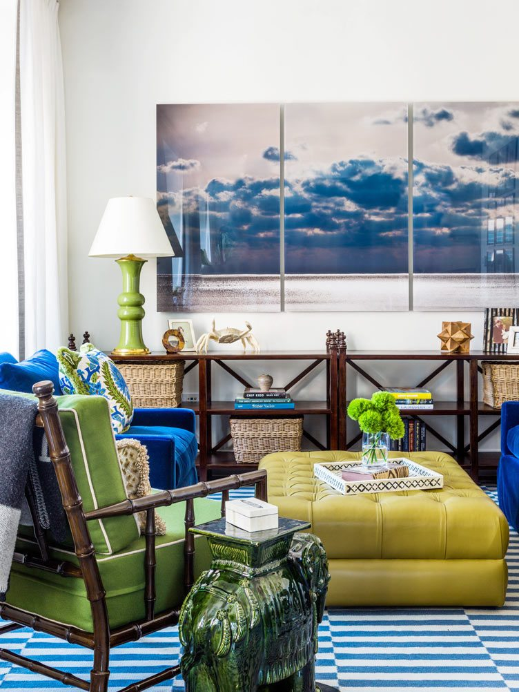 3 Panel Photo, short wooden bookshelf, aqua blue chair set, and deep yellow ottoman