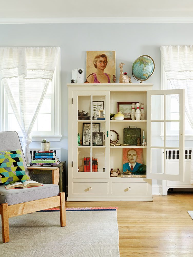 Living Room Bookshelf Decorated with Vintage Portraits.