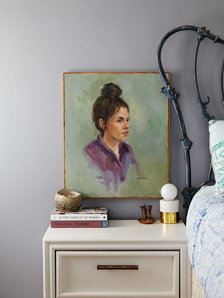 Vintage Portrait of Female Hanging over Bed Side Table.
