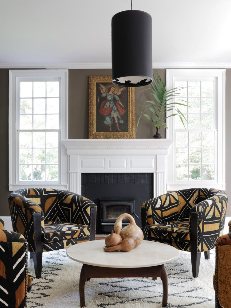 Traditional Living Room with Patterned Armchairs and Vintage Painting.