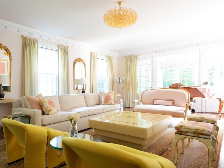 Peach Colored Living Room with Traditional Louis Sofa and Crystal Chandelier.