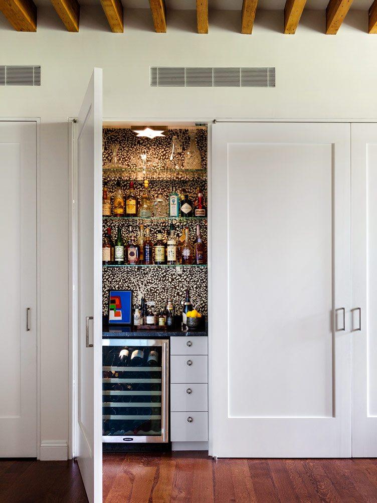white cabinets hidden bar wine fridge wood floor industrial exposed ceilings Chairish Tilton Fenwick