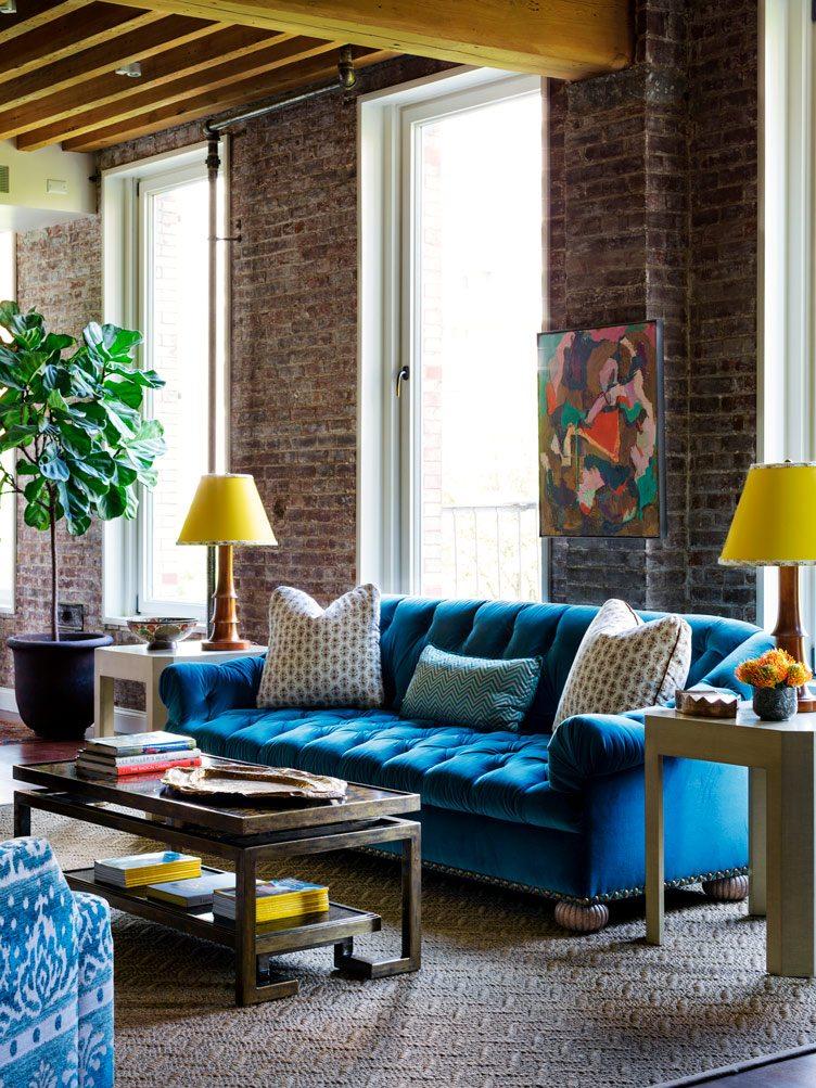 Tilton Fenwick interior design blue sofa yellow ceiling lamps bright green plant wood furniture Chairish