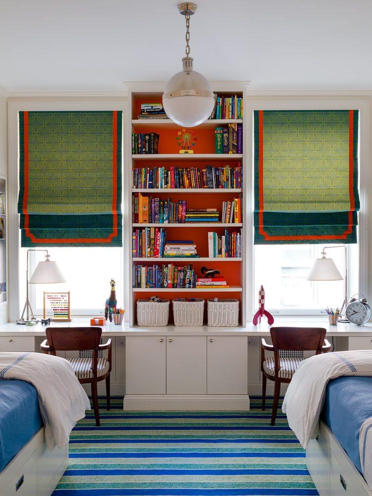 Tilton Fenwick interior design twin bedroom symmetrical blue green red bookshelf striped carpet