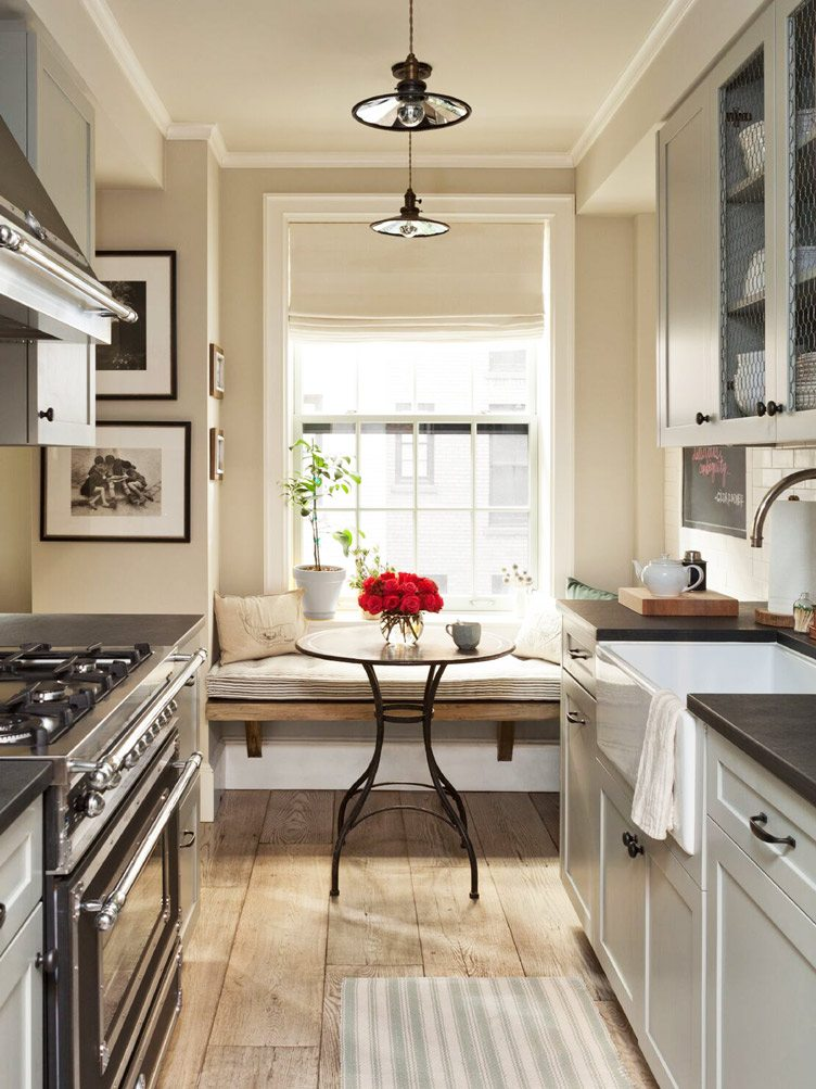 Classic Kitchen With Black Countertops and Beige Walls on Chairish.