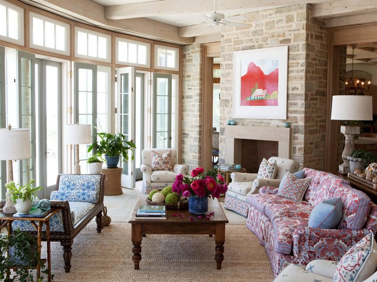 Traditional Living Room With Heavily Patterned Upholstery and Decorative Pillows