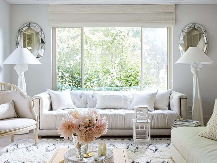 Traditional Living Room with White Couch paired with Trompe l'Oeil Draped Standing Lamps