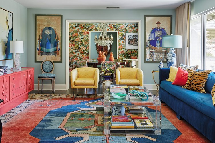 Maximalist Living Room With Textile Rug and Colorful Furniture under Large Vintage Hanging Art