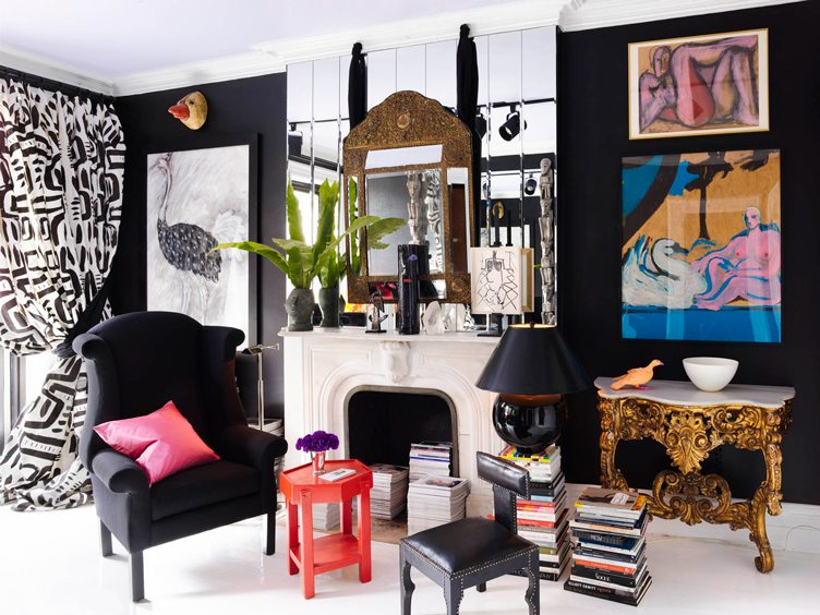 Maximalist Living Room with A Black and White Color Schemes and Pops of Color From Hanging Art and Stacks of Books on Chairish.