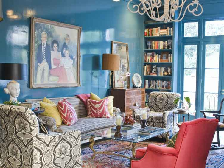 Traditional Living Room with a Maximalist Twist Represented in Pops of Color and Mixed Patterns in the Armchairs and Pillows on Chairish.