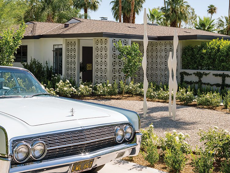 Palm Springs Florida home pierced concrete walls modern blue car abstract art statues exterior