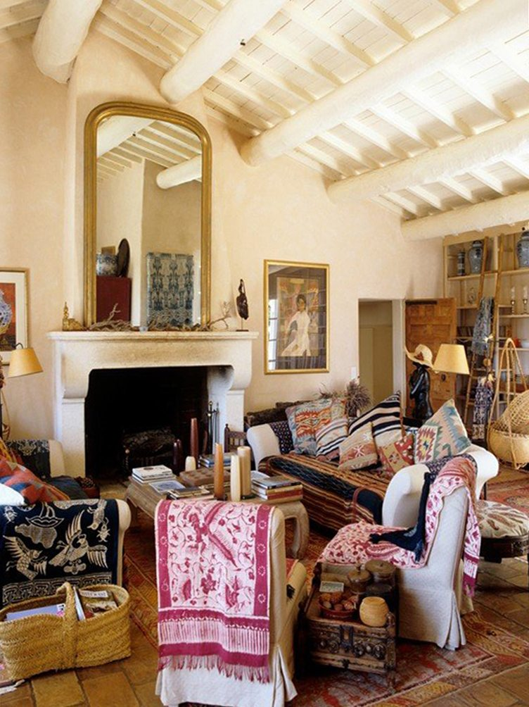 Haute Bohemian Living Room with a Mixture of Textile Pillows, Throw Blankets, and Rugs