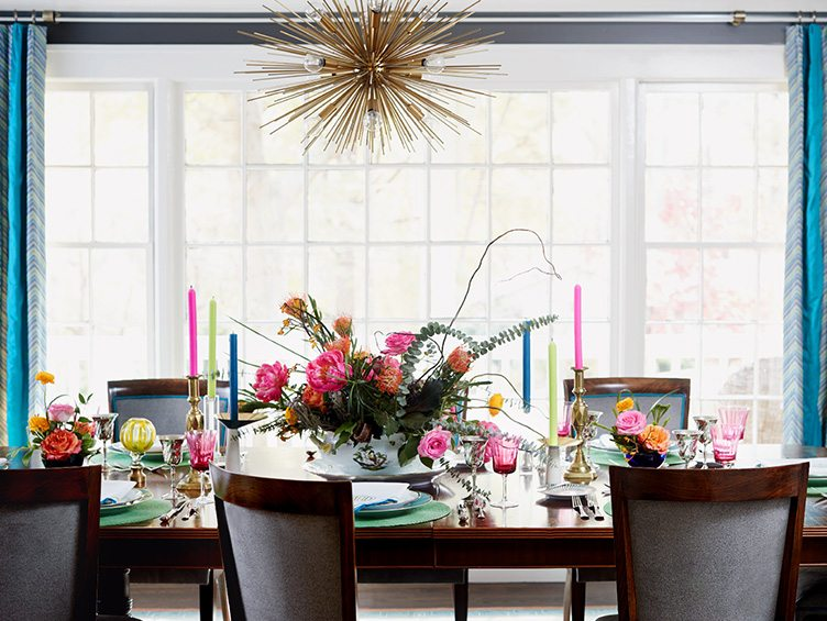 Dining Room Table Set with Vintage Tableware and Colorful Candlesticks.