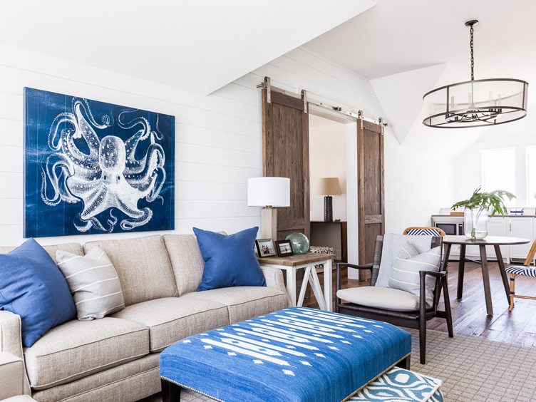 Lawson style sofa, blue ottoman, and dark gray armchair in living room