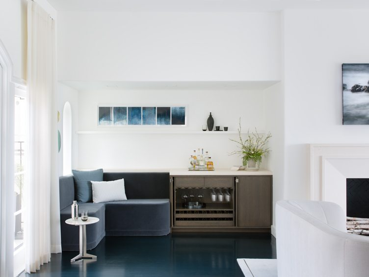 Contemporary Modern Home Bar with Blue Couch and Silver Barware.