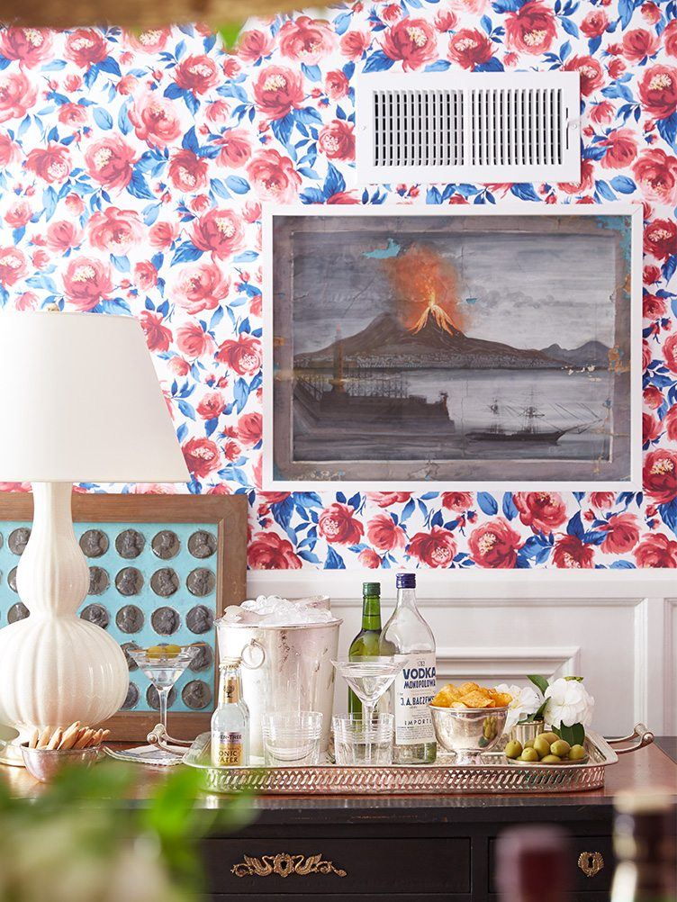 Dining Room with Colorful Floral Wallpaper and Volcano Painting on Chairish.