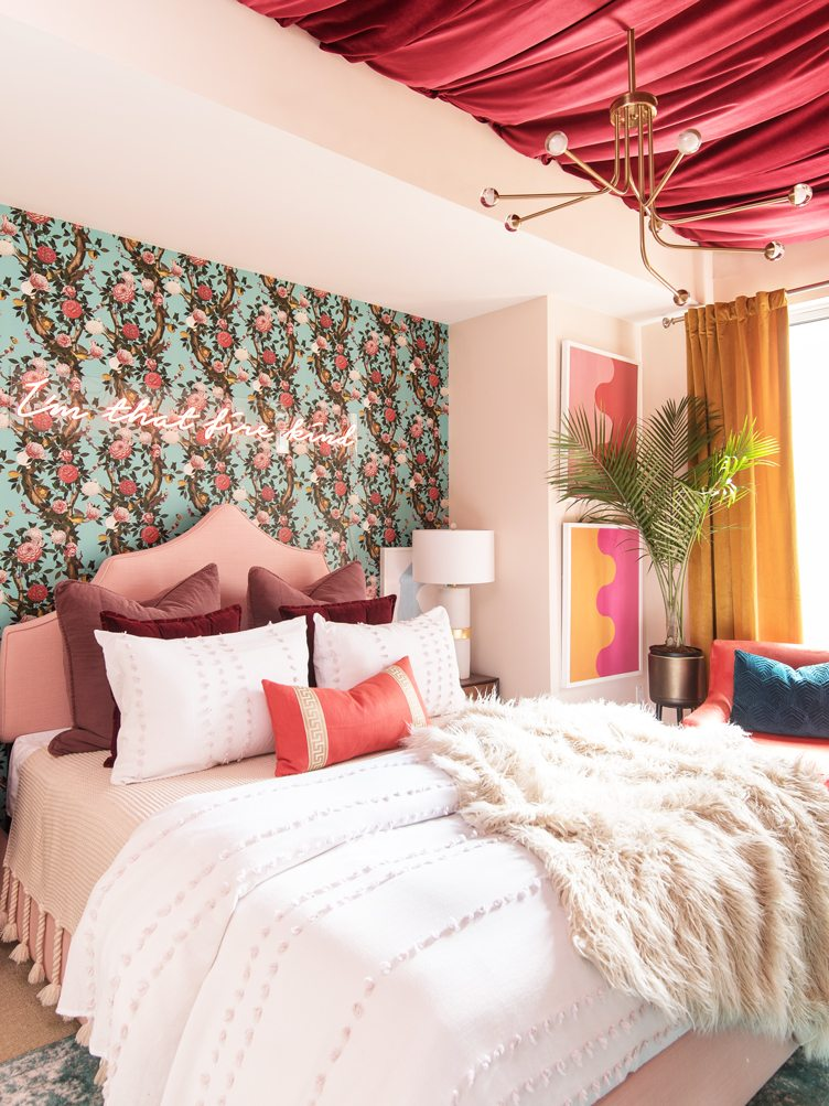 Pink Master Bedroom with Pink Neon Lit Cursive Letters and Pink Drapery on the Ceiling.