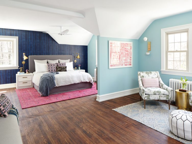 Colorful Bedroom with Pink Carpet, Blue Walls, and Pink Abstract Print Art.