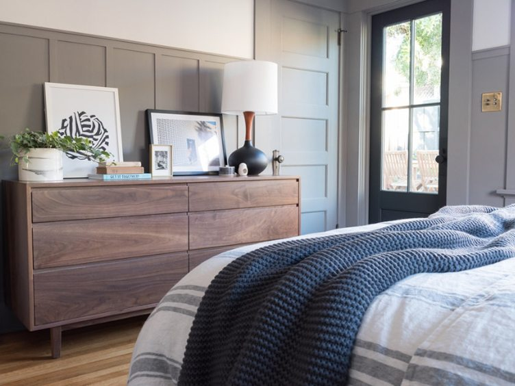 Master Bedroom with Wooden Dresser and Contemporary Print Artwork.
