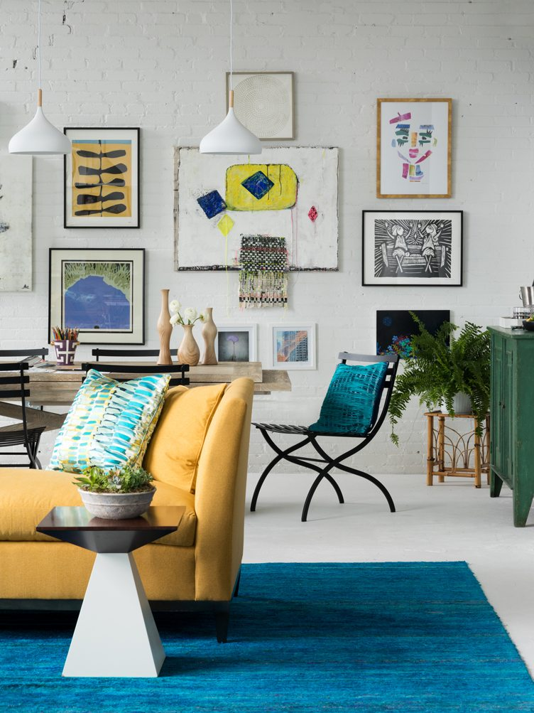 Eclectic Living Room With Gallery Wall of Vintage Artwork and Contemporary Prints.